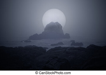 Moonlit foggy sea coast - Rocky coast in a foggy full moon...