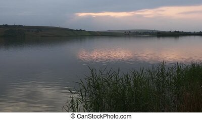 Evening Lake Scenery - Evening lake scenery with sun...