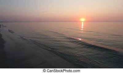 Sun Rising over Sea Horizon, Suntra - The sun rising over...