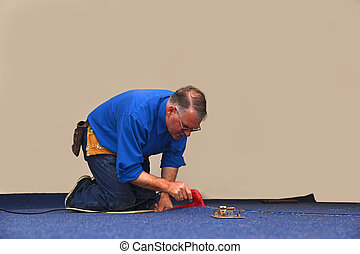 sealing the join - A floorlayer uses a hot iron to seal the...