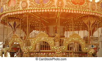 Children merry-go-round in slow motion - Carousel...