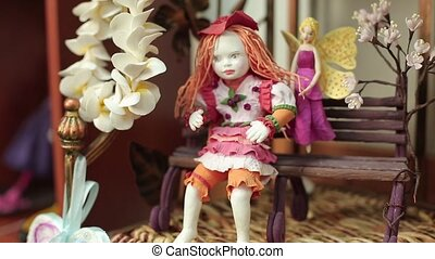 Decorative doll and spring flowers.