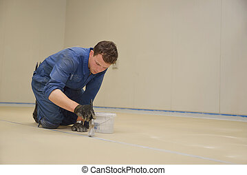 epoxy surface for floor - tradesman painting edge of floor...