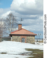 Smithy on coast of lake. Spring, Russia