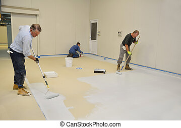 epoxy surface for floor - tradesmen rolling final coat of...