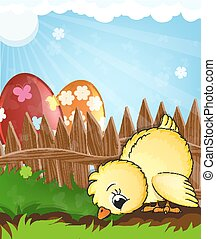 Chicken and painted eggs near a wooden fence