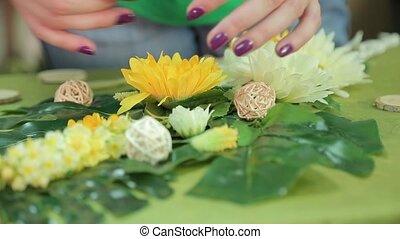 Girl making spring floral applique