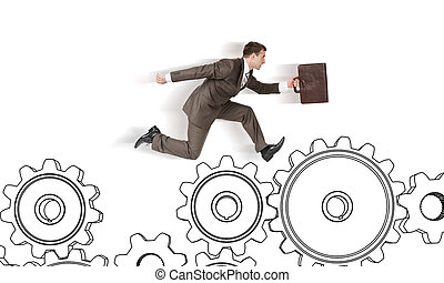 Businessman running on cog wheels isolated on white...
