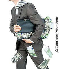 Businessman holding briefcase full of money