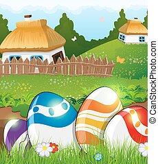 Easter eggs in the grass and rural houses - Painted Easter...