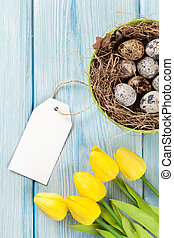 Easter with eggs and yellow tulips