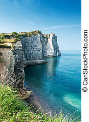 The white cliffs of Étretat overlooking the famous Natural...