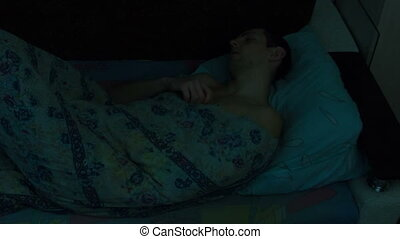 Sleeping Man on Bed Time Lapse - Man sleeping on the couch...