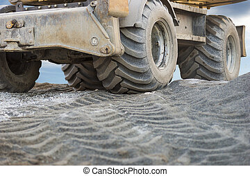 Excavator on building site - Close up of wheel of excavator...