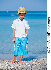 Boy walking the tropical beach - Stylish kid boy walking the...