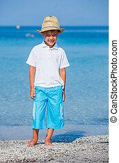 Boy walking the tropical beach - Stylish kid boy walking the...