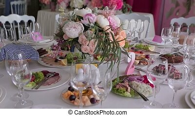 Festive table with flowers and glasses