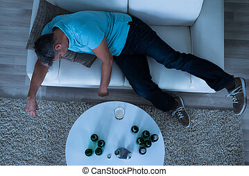 Man Taking A Nap On Sofa At Home - Mature Man Taking A Nap...
