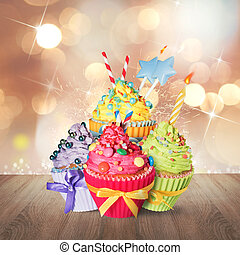 Birthday cupcake - Colored sweet cupcake with decorations...