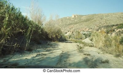 Offroad through a riverbed Andalusia, Spain - Offroad...