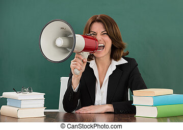 Female Teacher Shouting Through Megaphone - Young Female...