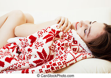 young pretty brunette girl in Christmas ornament blanket...