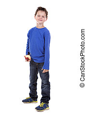 thrilled boy holding and apple - six years old boy wearing...