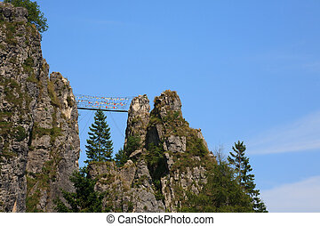 Tibetan bridge along a mountain trekking path, Italian Alps,