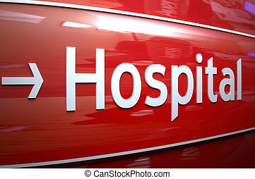HOSPITAL - White Hospital sign on the shiny remarkable red...