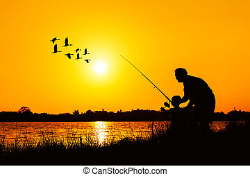 father and son fishing in the river sunset backgrond