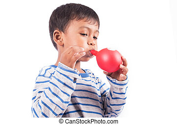 happy little boy blowing balloon