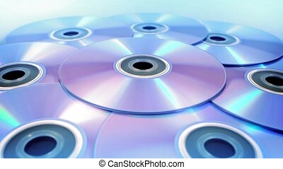 Blank DVDs Rotating Slowly - DVDs turning slowly on plain...