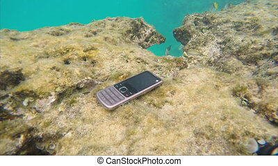 Finding the phone into the sea, raising from the bottom of