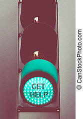 Close up on green traffic light message GET HELP - Close up...