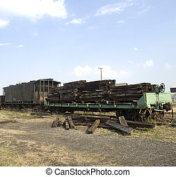 old railroad ties - flatbed railroad car loaded with...
