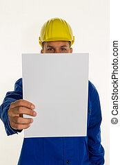 craftsman with empty sheet - a handyman holding a blank...