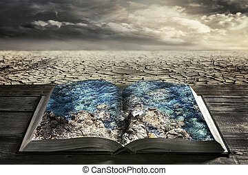 open book with clean water on a background dry earth