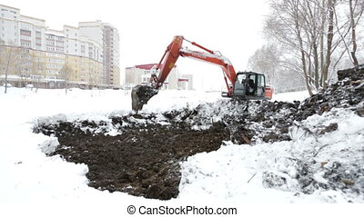 excavator digging the ground in the winter Previous