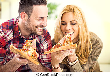 Pizza - Portrait of an happy couple.They are laughing and...
