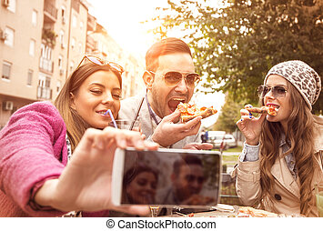 Pizza time - Group of young people laughing and doing a...