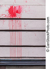 red ink splashes on a wall, a symbol of red, criminal...