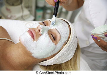 young beautiful woman with facial mask,