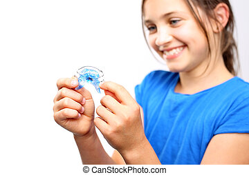 Orthodontic - Pretty girl with colored orthodontic appliance...
