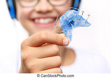 orthodontic - Portrait of a little girl with orthodontic...