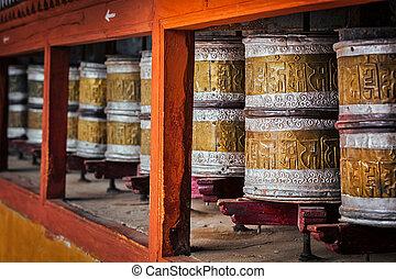 Buddhist prayer wheels in Hemis monstery, Ladakh - Buddhist...