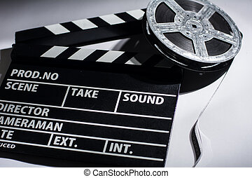 Close-up of cinema clap and film reel with Background for...