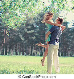 Sweet couple in love in spring sunny day