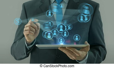 Business man pointing on social network media concept tablet...
