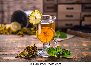 Glass cup tea with mint leaf and lemon