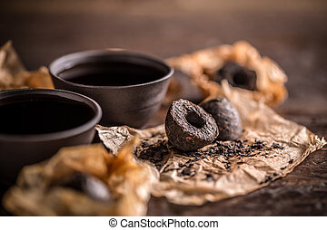 Pu erh tea - Chinese clay bowls of pu erh tea